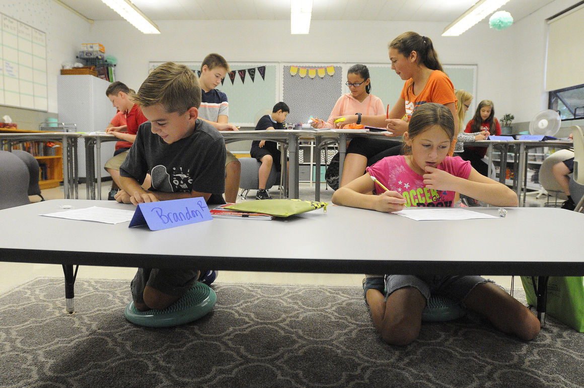 Sixth Graders Brandon Regnier Left And Sophia Longtin Sit On Wobble Cushions At The Low Table In Ami Maricles Math Class Wednesday Bradley Central