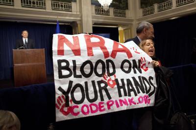 Scandal-ridden NRA head LaPierre digs in against gun control