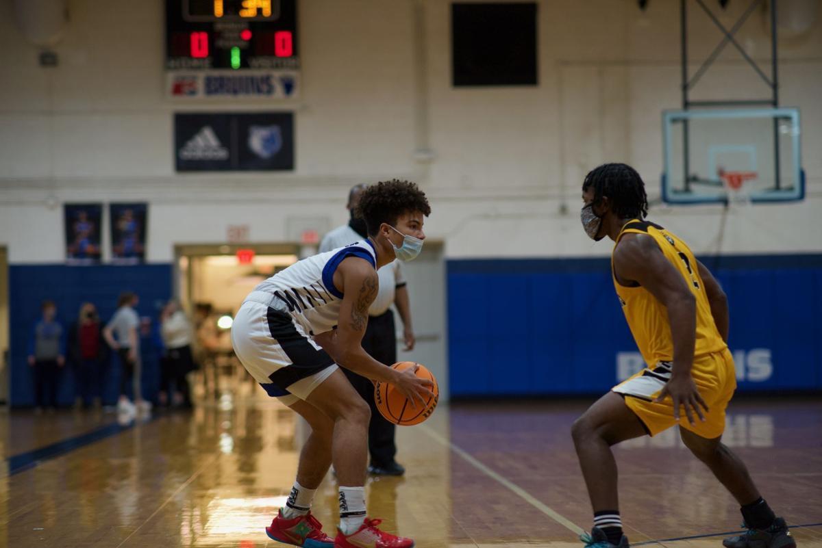 021621_eda_basketball_camden_Perquimans_barnett_gatling_basketball_boys