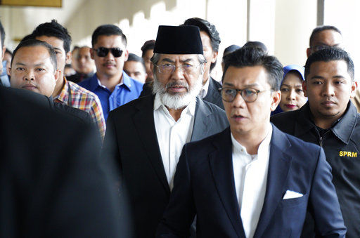 Malaysian ex-state chief charged as graft crackdown widens