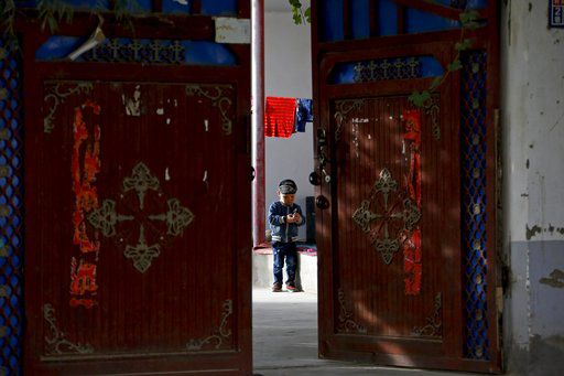 China's model village of ethnic unity shows cracks in facade