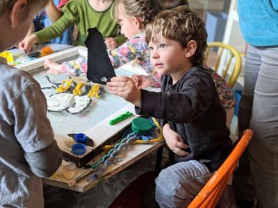 Preschoolers turn plastic debris into art