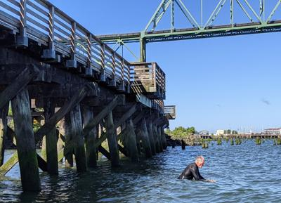 Tim Kennedy swims in Columbia River