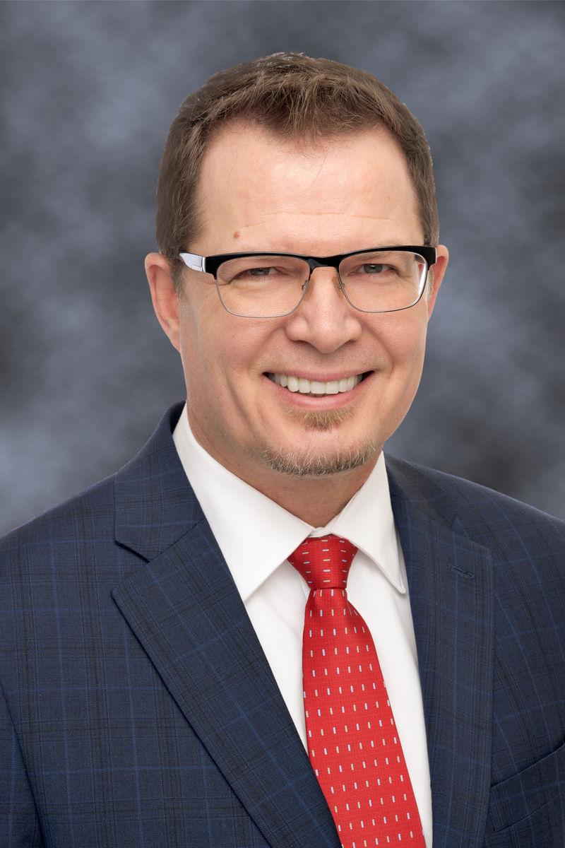 Dr. Kevin Baxter