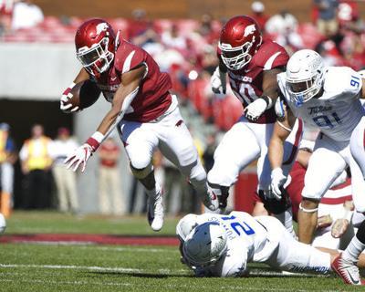 Noland, defense help Arkansas shut out Tulsa, 23-0
