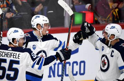e8195c9073c Laine s hat trick lifts Jets over Panthers 4-2 in Helsinki ...