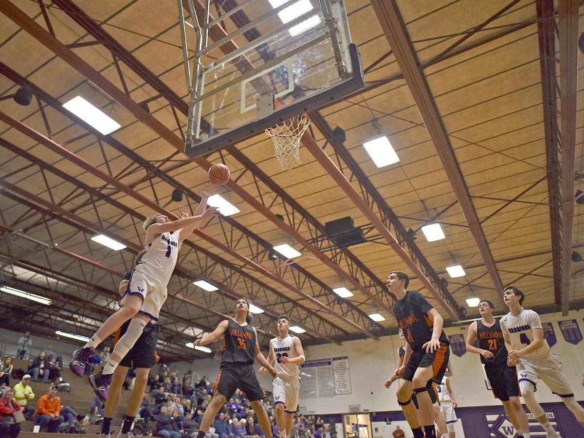 Dalton Knight drives to the basket