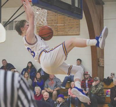 Eli Takalo dunks in victory