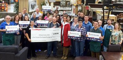 Fred Meyer gives funds to CASA