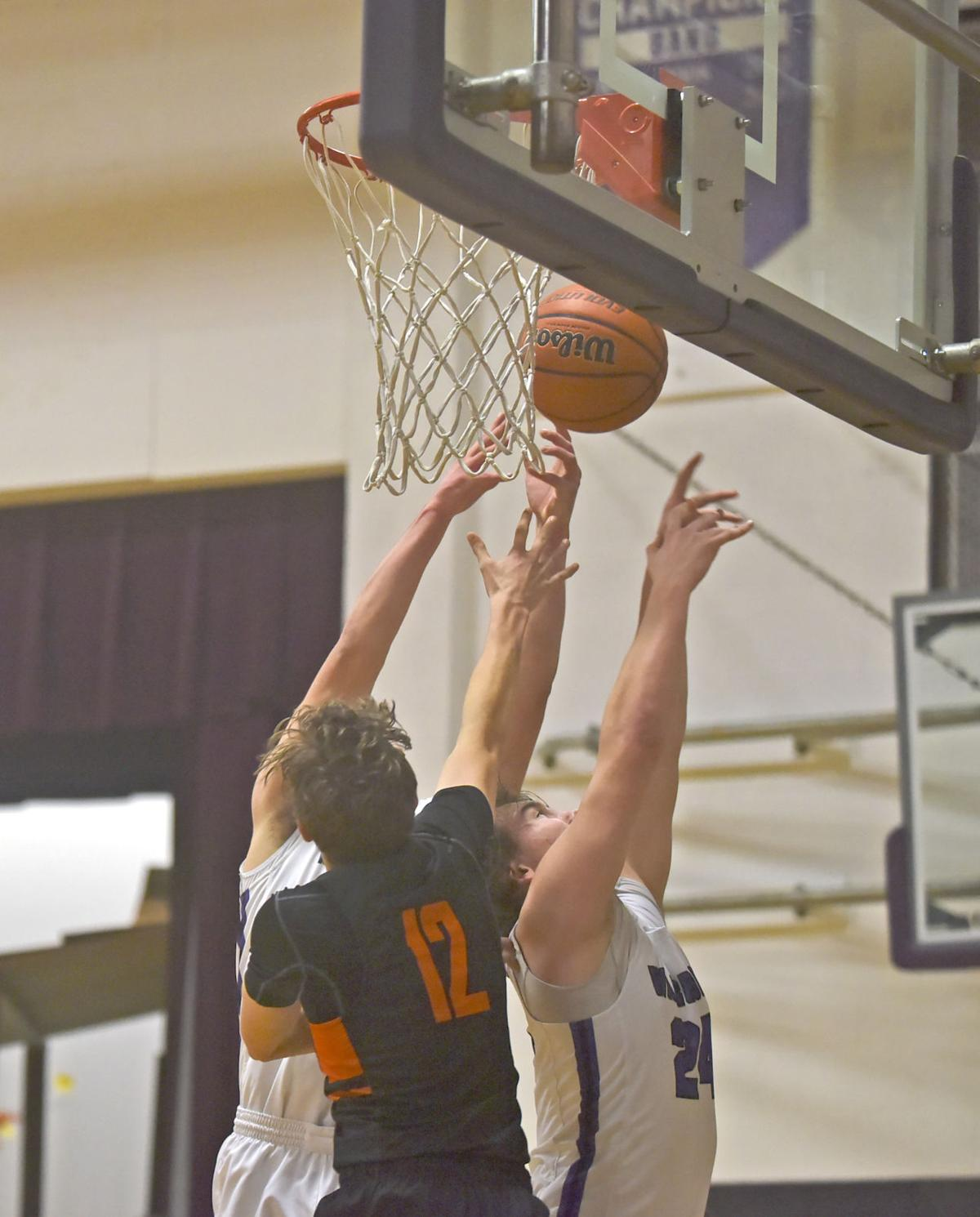 Warrenton player battle for a rebound