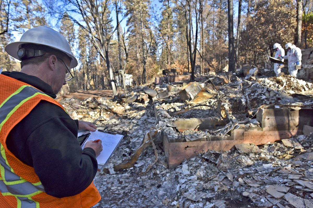Hazmat team sifts through wreckage of a home