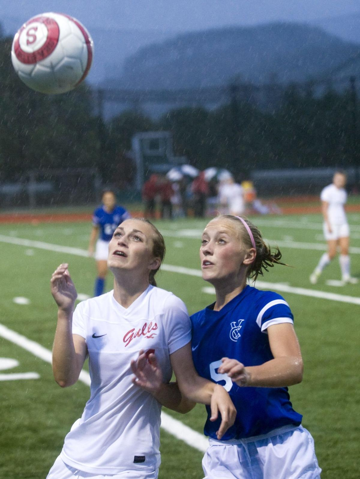Seaside girls slosh to soccer loss in first game