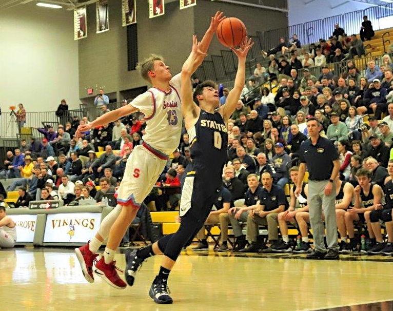 Beau Johnson battles for basketball