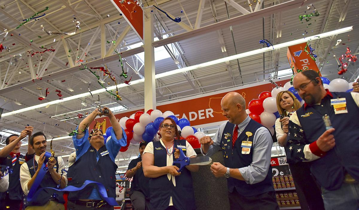 Walmart employees cut the ribbon