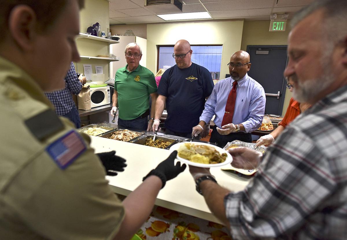Volunteers serve Thanksgiving food, friendship in Seaside