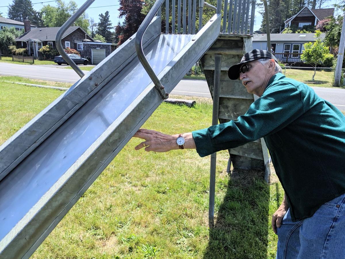 Neighbors help repair park play equipment