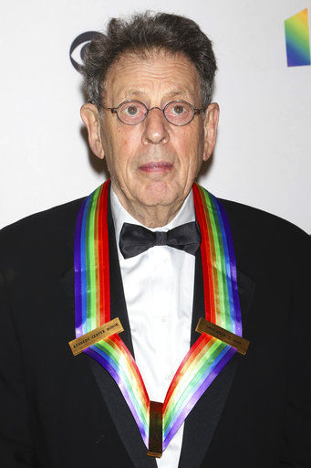 The Latest: Composer Philip Glass praised by Paul Simon
