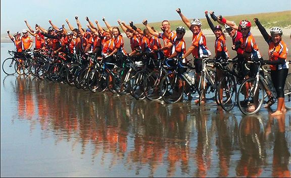 Cyclists ride to coast for housing ministry