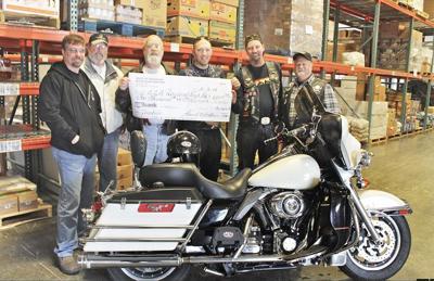 Bike group gives to Food Bank