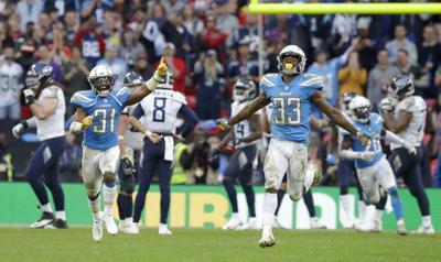Chargers withstand Titans' late rally, hold on for 20-19 win