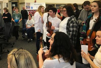 Music boosters support strings teacher