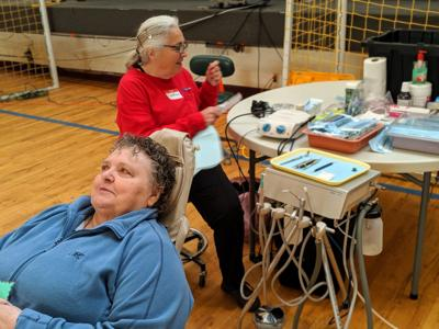 Astoria woman gets cleaning at free dental clinic