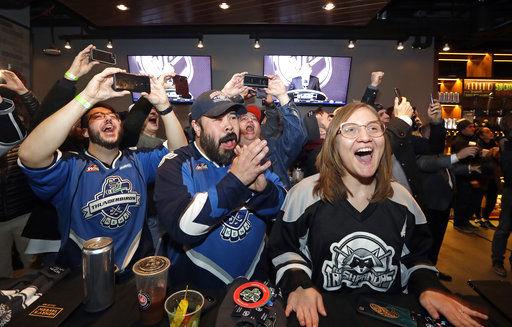 The Latest: Seattle fans cheer NHL announcement, wait begins