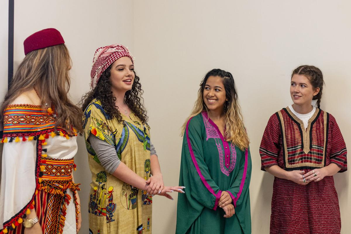 Faten Arfaoui with students at the 41st Annual Foreign Language and International Studies Day