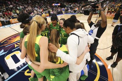 Oregon women's basketball huddles after Final Four loss