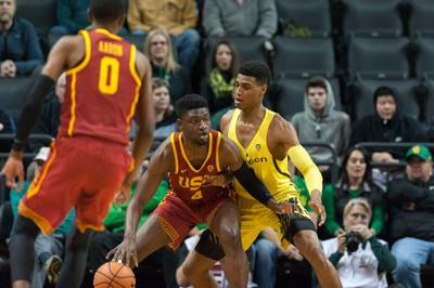 Ducks lose the rebounding battle, fall to USC 75-70