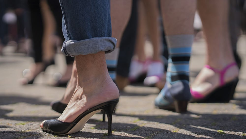 In Her Shoes event sees women and men walking in heels to raise awareness about domestic violence, hosted by AXO