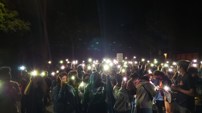 Oct. 7 Protesters w flashlight_James