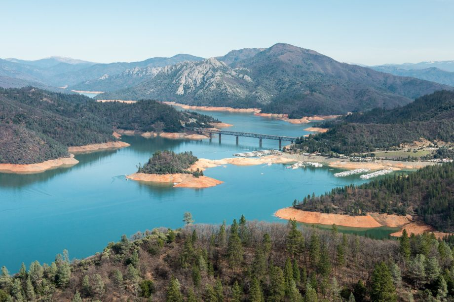 Post shows photos of trash, UO gear littered around a Shasta Lake island