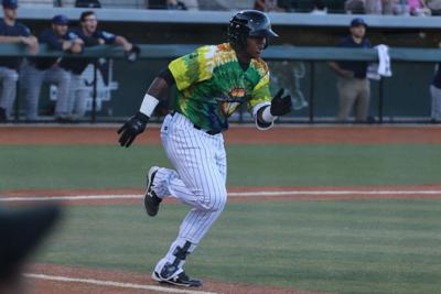 Walks, runners left on base and extra inning rule help AquaSox down Emeralds 7-4