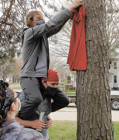 DSU organization hangs red dresses to raise awareness; 19 Native American teen girls reported missing in S.D. since January