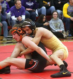 <p>MADISON TRUMAN STOLLER (right) is in control of Dell Rapids' Andrew Weiland in the 113-pound championship match of the Region 1A Tournament on Saturday in Brookings. Stoller went on to gain an 8-1 win and claimed the championship.</p>