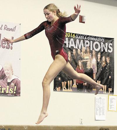 Lady Bulldogs down AA Huron in gymnastics dual