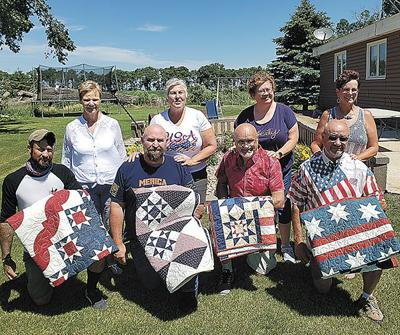 Surprise quilts presented to Lemme family veterans