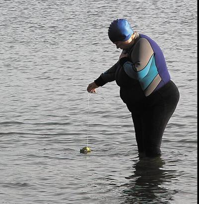 Nordic custom provides local woman with regular exercise; Kiin swims in Lake Herman