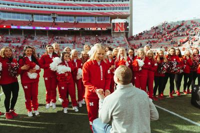 On field proposal surprises cheerleader after Husker football game