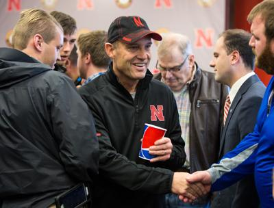 Mike Riley shakes hand with reporters