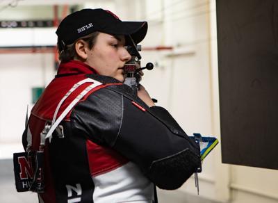 Emily Cheramie prepares to shoot air rifle