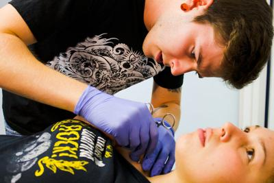 Apprentice gains invaluable experience from Big O Tattoo body ...