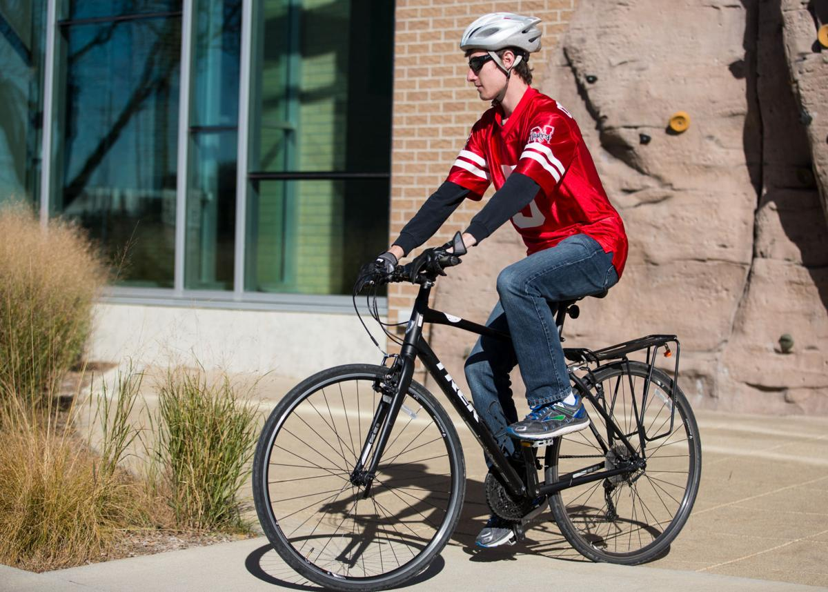 kennedy krikac rides his bike for the annual halloween costume bike ride presented by bike unl outside the outdoor adventures center in lincoln nebraska