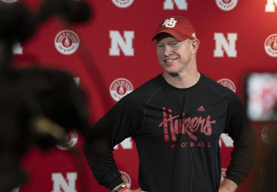 Scott Frost smiles as he responds to media