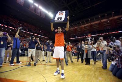 df97d3311 UVA s Malcolm Brogdon holds up his jersey during senior night celebrations  before the game against Louisville