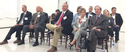Candidates await the beginning of the Chamber of Commerce forum