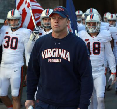 12881797cac5 The Cavaliers kick off Mendenhall s second season on Sept. 2 against William    Mary.