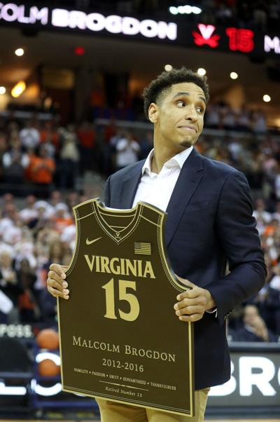 fd5bc4a9ce3 Malcolm Brogdon is recognized during a ceremony to retire his number before  the start of Monday s game against Miami in Charlottesville.