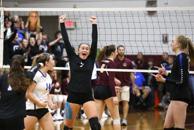 Maggie Butters (#7) celebrates one of her 13 kills for the match.
